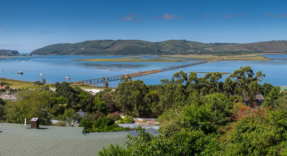 View from Hamilton Manor over lagoon towards the Heads, with Paradise view self catering house directly in front with green roof