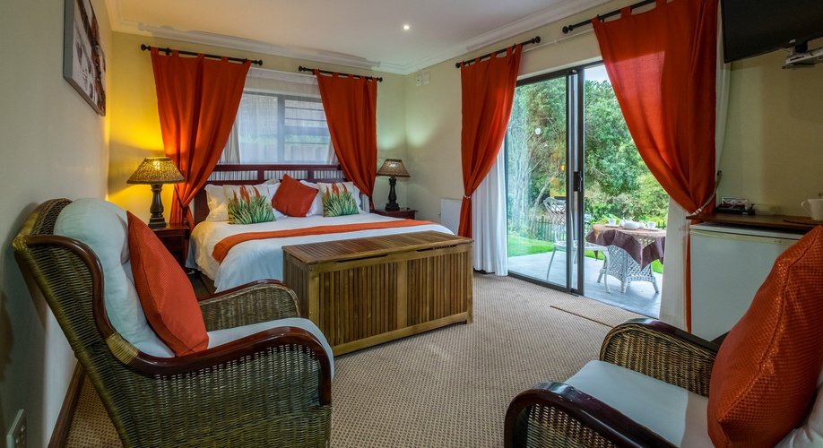 Suite 2 overlooks a lovely little garden with a water feature and distant views of the Lagoon.